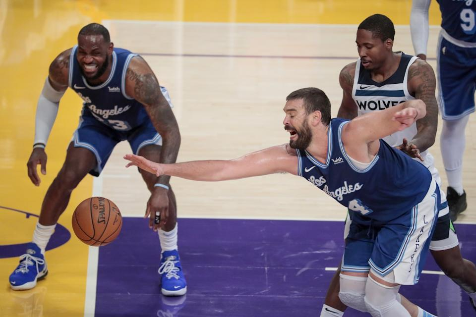 Lakers center Marc Gasol tries to corral a loose ball in front of teammate LeBron James against the Timberwolves.