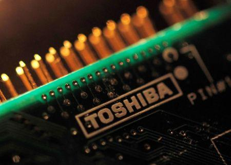 FILE PHOTO : A logo of Toshiba is seen on a printed circuit board in this photo illustration taken in Tokyo