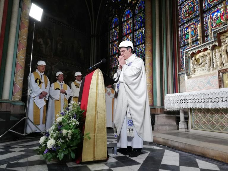 The Archbishop of Paris Michel Aupetit leads the first mass held in Notre Dame, in a side chapel, following the fire (AFP Photo/Karine PERRET)
