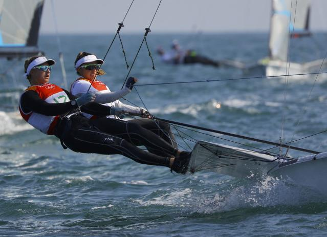 2016 Rio Olympics - Sailing - Preliminary - Women's Skiff - 49er FX - Race 7/8/9 - Marina de Gloria - Rio de Janeiro, Brazil - 15/08/2016. Alex Maloney (NZL) of New Zealand and Molly Meech (NZL) of New Zealand compete. REUTERS/Brian Snyder FOR EDITORIAL USE ONLY. NOT FOR SALE FOR MARKETING OR ADVERTISING CAMPAIGNS.