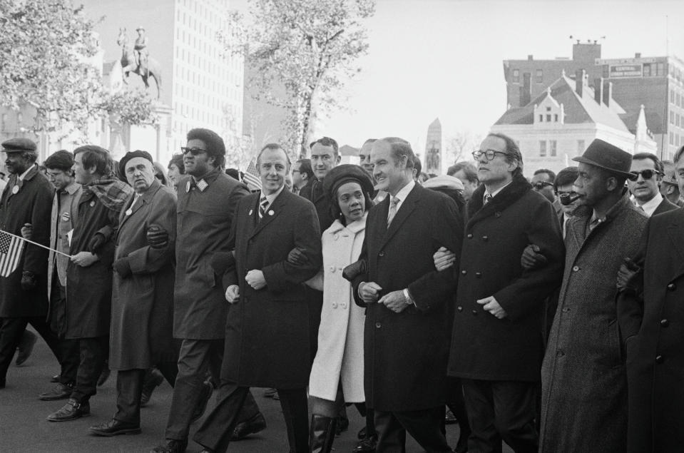 Marching in an anti-war parade down Pennsylvania Avenue in Washington, are left to right: Sen. Charles Goodell (R-N.Y.), Coretta Scott King and Sen. George S. McGovern (D-S.D.).