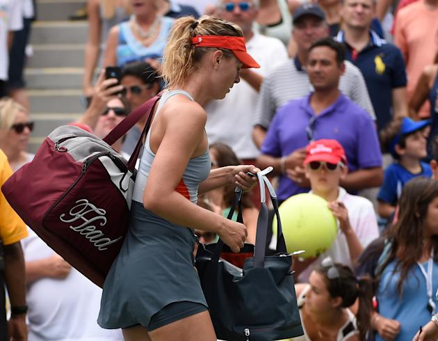 Maria Sharapova signs some autographs on the way out, after losing to Caroline Wozniacki at the U.S. Open Sunday. (Robert Deutsch-USA TODAY Sports)