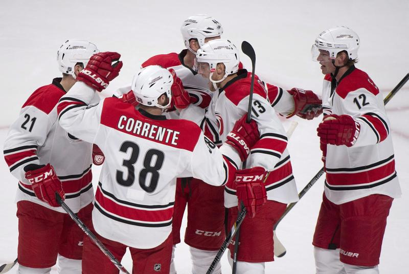 Carolina Hurricanes celebrate a first-period goal against the Montreal Canadiens during an NHL hockey preseason game in Montreal, Saturday, Sept. 21, 2013. (AP Photo/The Canadian Press, Graham Hughes)