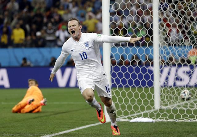 Uruguay's goalkeeper Fernando Muslera looks back as England's Wayne Rooney celebrates after scoring his side's first goal during the group D World Cup soccer match between Uruguay and England at the Itaquerao Stadium in Sao Paulo, Brazil, Thursday, June 19, 2014. (AP Photo/Kirsty Wigglesworth)