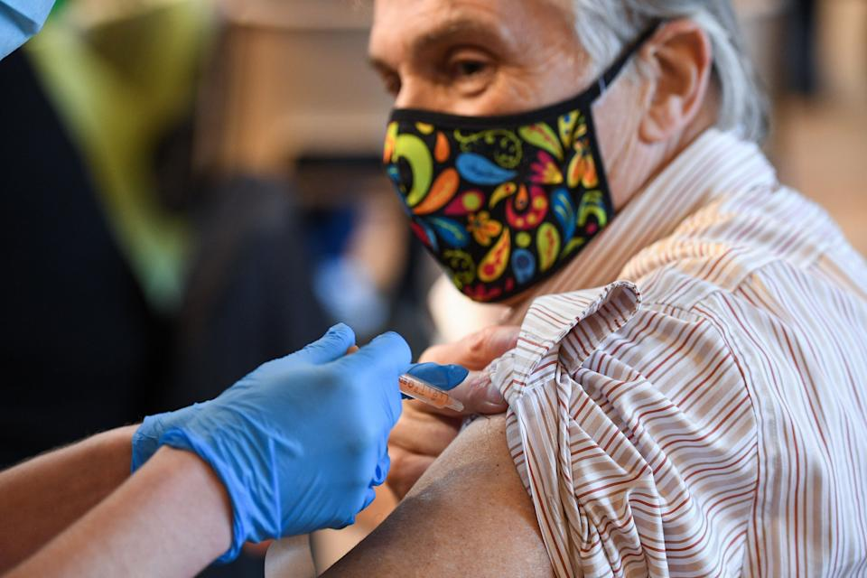 A member of the public receive the Oxford-AstraZeneca Covid-19 vaccine at a temporary vaccination centre in St Columba's Church in Sheffield. (Photo: OLI SCARFF via Getty Images)