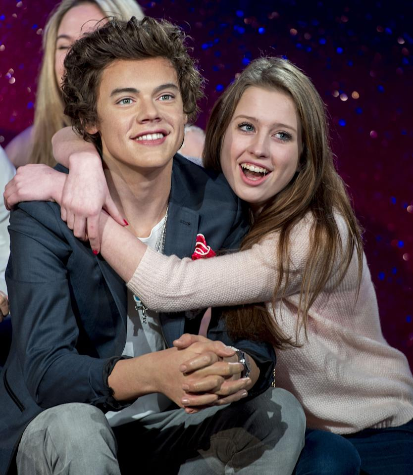 LONDON, ENGLAND - APRIL 18:  One direction fans get a look at the Waxwork of Harry Styles as One Direction waxworks are unveiled at Madame Tussauds on April 18, 2013 in London, England.  (Photo by Mark Cuthbert/UK Press via Getty Images)