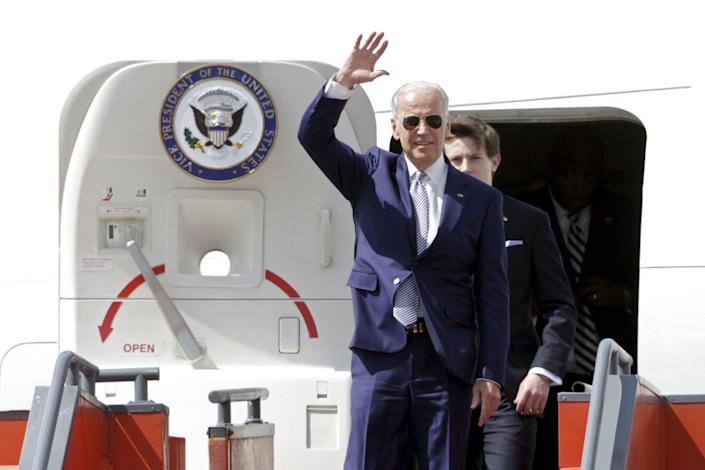 U.S. Vice President Joe Biden waves as he walks out of the plane upon his arrival for the inauguration of Guatemala's President-elect Jimmy Morales, at Aurora international airport in Guatemala City, Guatemala, January 14, 2016.
