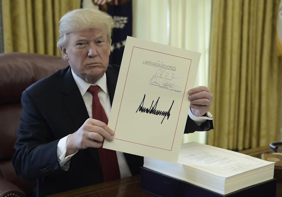 US President Donald Trump signed into law a sweeping overhaul of the US tax code, shortly before departing on a year-end break at his Mar-a-Lago resort in Florida (AFP Photo/Brendan SMIALOWSKI)