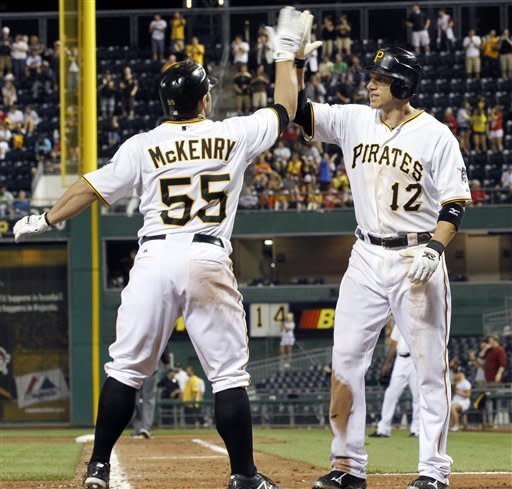Pittsburgh Pirates' Clint Barmes (12) greets Michael McKenry after scoring McKenry hit a two-run homer to tie the game in the seventh inning of the baseball game against the New York Mets on Monday, May 21, 2012, in Pittsburgh. The Pirates won 5-4. (AP Photo/{Keith Srakocic})