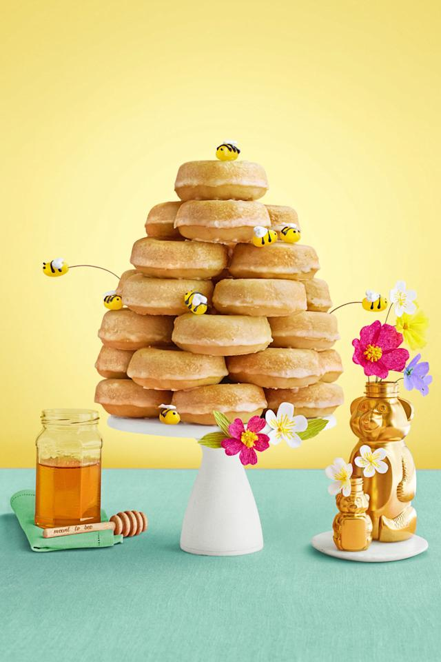 "<p>Your kids will be all abuzz once they see this ""honeycomb"" tower on the dessert table.</p><p><strong><a rel=""nofollow"" href=""http://www.womansday.com/food-recipes/food-drinks/recipes/a58524/glazed-honey-doughnut-beehive-recipe/"">Get the recipe</a>.</strong><span></span></p>"