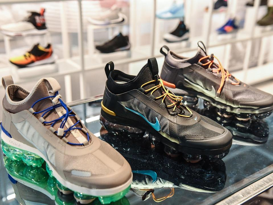 <p>Nike sneakers are seen on display at the Nike flagship store on 5th Ave. on 20 December 2019 in New York City</p> ((Getty Images))