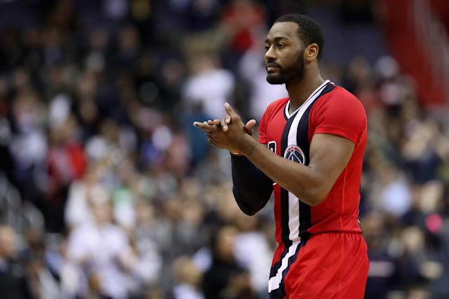 John Wall gives himself a hand. He's earned it. (Getty Images)