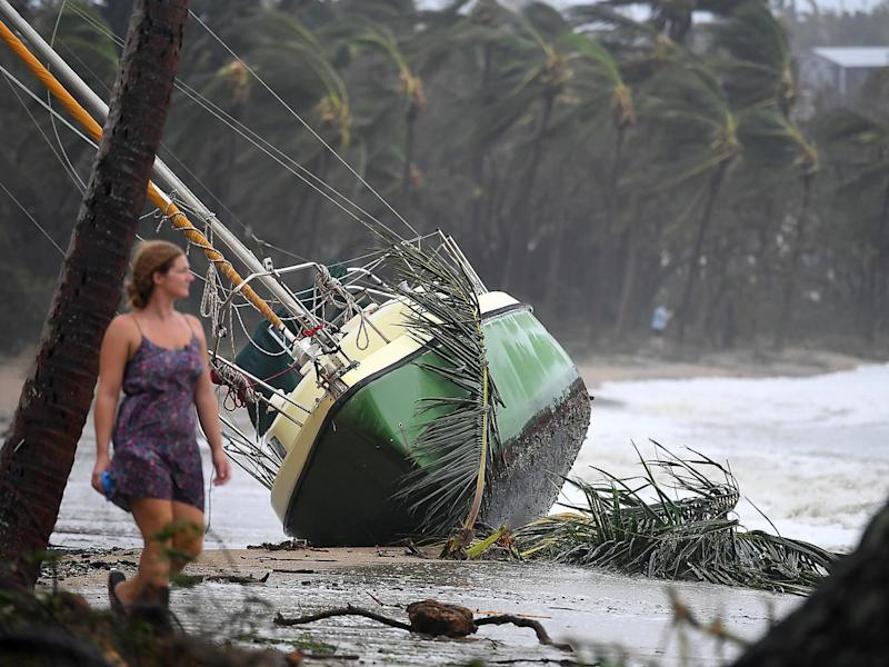 A boat is washed ashore at Airlie Beach, Queensland, Australia (EPA)