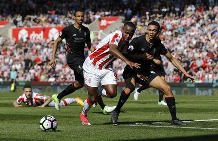 Stoke City's Saido Berahino in action with Liverpool's Trent Alexander-Arnold