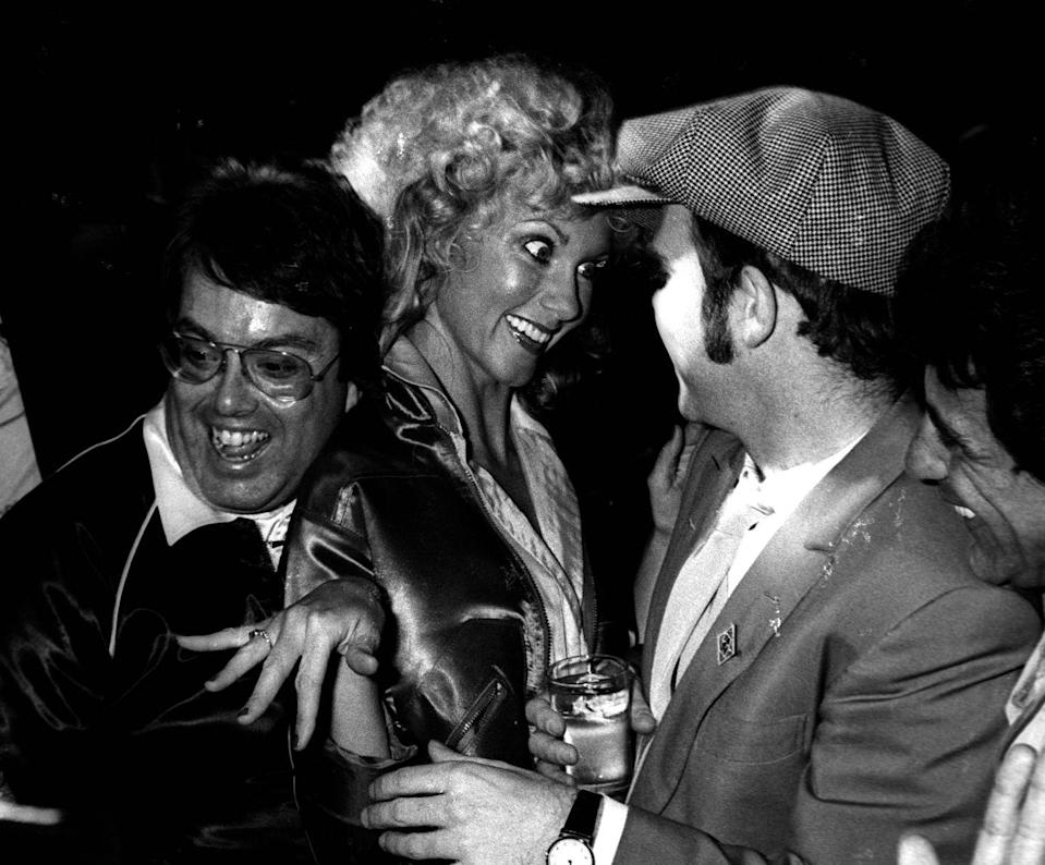 <p>Producer Allan Carr, Olivia Newton-John, and Elton John attend the premiere party for <em>Grease</em> on June 13, 1978 at Studio 54 in New York City.</p>