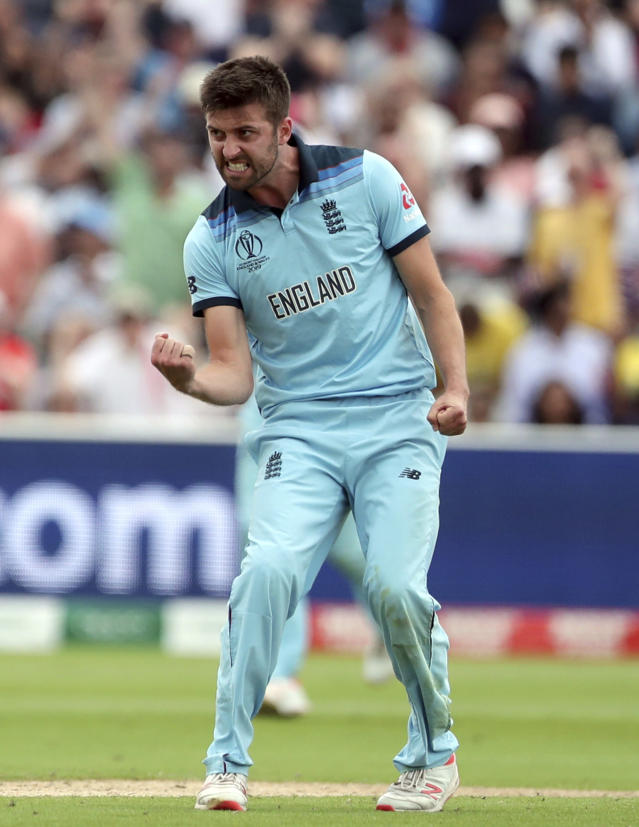 England's Mark Wood celebrates the dismissal of Australia's Jason Behrendorff during the Cricket World Cup semi-final match between England and Australia at Edgbaston in Birmingham, England, Thursday, July 11, 2019. (AP Photo/Aijaz Rahi)