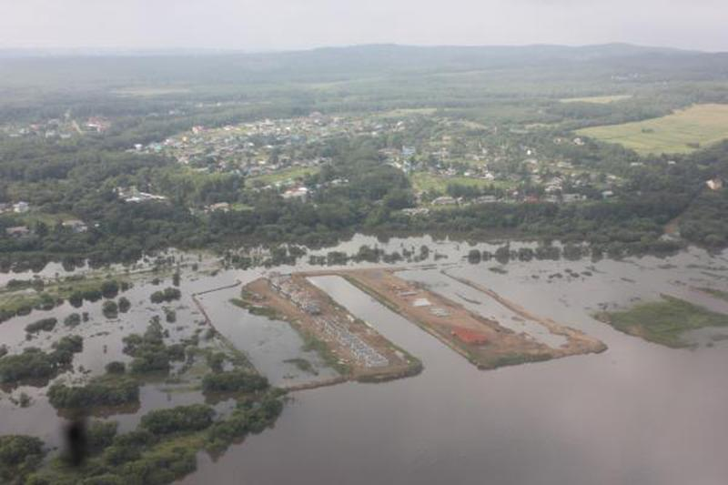 In this Thursday, Aug. 15, 2013 photo provided by the Russian Emergency Ministry, Khaabarovsk region branch, shows the aerial view of a flooded Amur River in the Khabarovsk region. The Russian Emergency Situations Ministry says around 20,000 people have been forced to leave their homes since July in the wake of floods in Russia's Far East. (AP Photo/ Russian Emergency Ministry, Khabarovsk region branch)