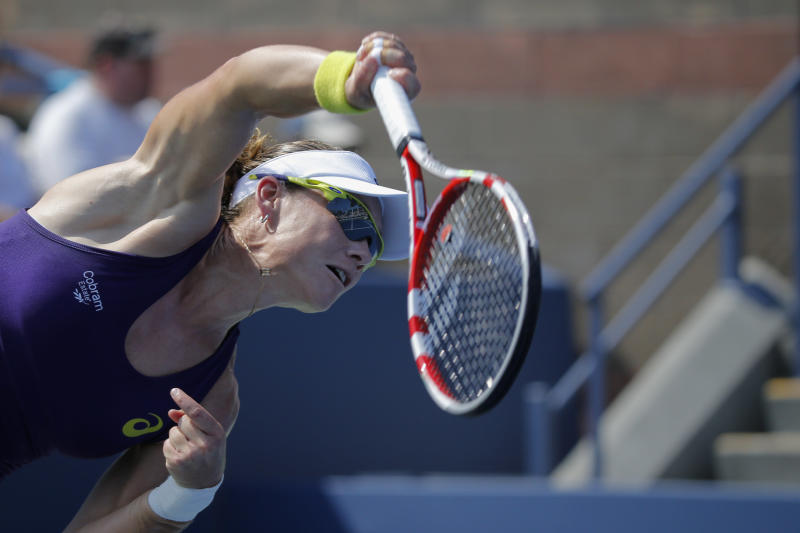 Samantha Stosur of Australia returns a shot to Lauren Davis of the US during the 2014 US Open women's singles match at the USTA Billie Jean King National Tennis Center August 26, 2014 in New York