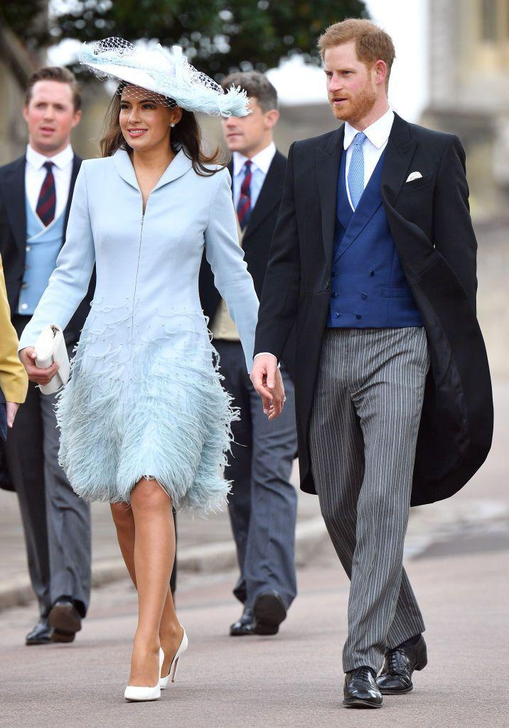 <p>Lady Frederick Windsor chose a bold oversized hat for her sister-in-law's wedding in 2019. Here she is walking alongside Prince Harry.</p>