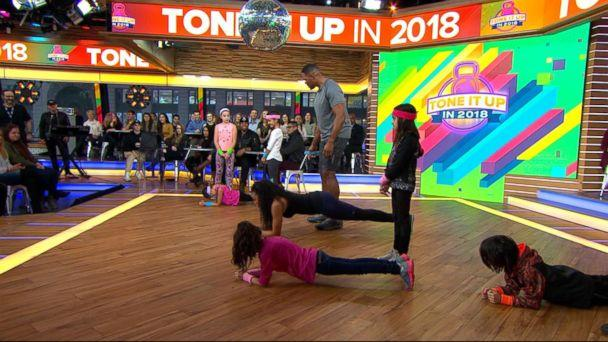 PHOTO: 'GMA' anchor Michael Strahan and celebrity trainer Latreal Mitchell demonstrate a partner workout move, Jan. 12, 2018. (ABC News)