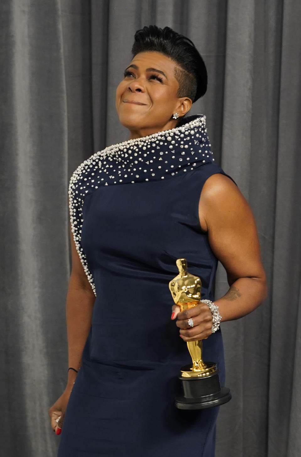 """Mia Neal, winner of the award for best makeup and hairstyling for """"Ma Rainey's Black Bottom,"""" poses in the press room at the Oscars on Sunday, April 25, 2021, at Union Station in Los Angeles. (AP Photo/Chris Pizzello, Pool)"""
