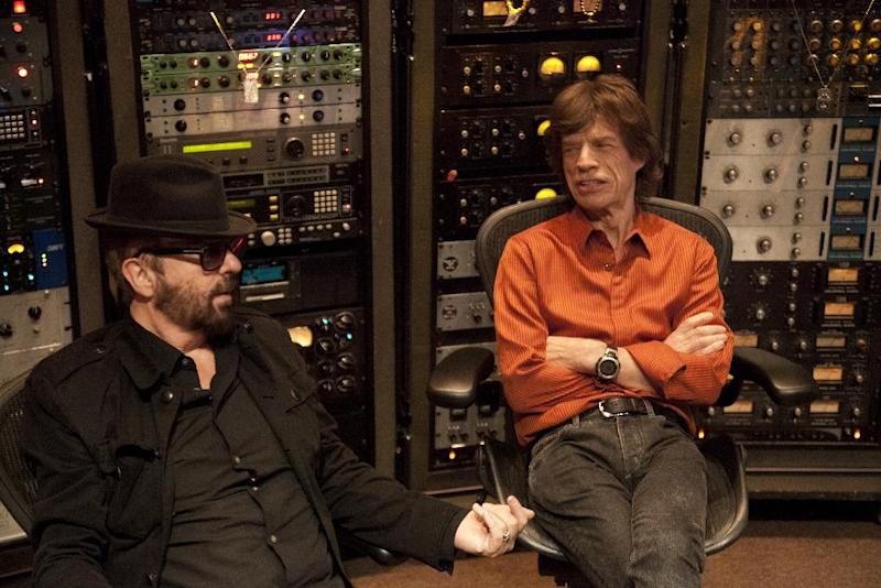 In this 2011 image released by SuperHeavy, Euythmics founder Dave Stewart, left, and Rolling Stones lead singer Mick Jagger of the new band SuperHeavy are shown at Henson Studio in Los Angeles. The band also consists of soulful singer-songwriter Joss Stone, Oscar-winning composer A.R. Rahman and reggae singer Damian Marley.  Their first album was released on Tuesday, Sept. 20, 2011. (AP Photo/SuperHeavy, Kristin Burns)