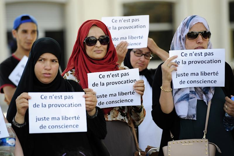 """Women at an anti-Islamophobia protest in Avignon last year, holding signs reading: """"It's not a provocation, just my freedom of conscience"""""""