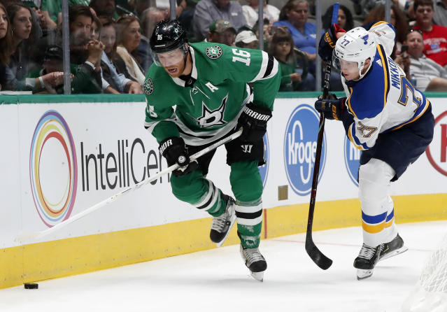 Dallas Stars center Joe Pavelski (16) and St. Louis Blues defenseman Niko Mikkola (77) compete for control of the puck in the first period of a preseason NHL hockey game in Dallas, Monday, Sept. 16, 2019. (AP Photo/Tony Gutierrez)