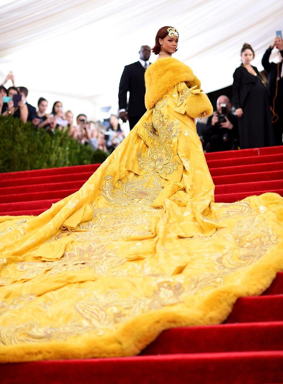 "<p>Never has a Met Gala look gone so instantly viral as the <a href=""https://www.harpersbazaar.com/uk/celebrities/red-carpet/g27330102/best-ever-met-gala-fashion-history/?slide=2"" rel=""nofollow noopener"" target=""_blank"" data-ylk=""slk:yellow cape gown Rihanna"" class=""link rapid-noclick-resp"">yellow cape gown Rihanna</a> wore in 2015 - popularly dubbed 'the omelette dress' - which sparked countless memes. The ornate look, by Chinese couturier Guo Pei, took 20 months to create and weighed approximately 55 pounds. </p>"