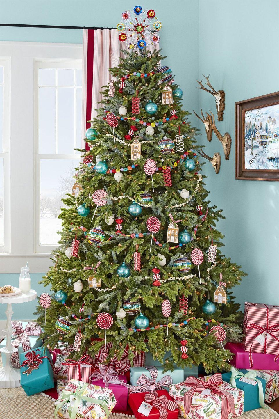 <p>Forget the candy dishes: Make your house even sweeter by decorating your Christmas tree with sugar-themed garland and ornaments (real candy ribbon included!). </p>