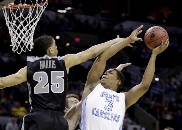 North Carolina's Kennedy Meeks (3) shoots as Providence's Tyler Harris (25) defends during the first half of a second-round game in the NCAA college basketball tournament Friday, March 21, 2014, in San Antonio. (AP Photo/Eric Gay)