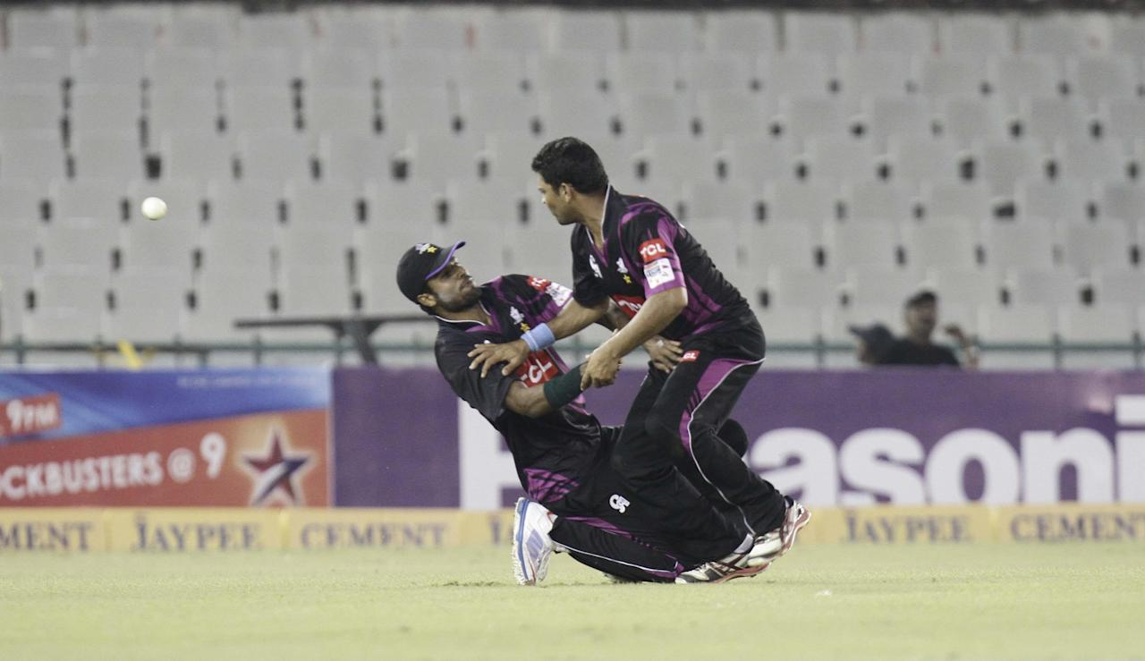 Faisalabad Wolves' players in action during the Champions League T20, 5th match between Faisalabad Wolves and Kandurata Maroons at Mohali stadium, Chandigarh on Sept. 20, 2013. (Photo: IANS)