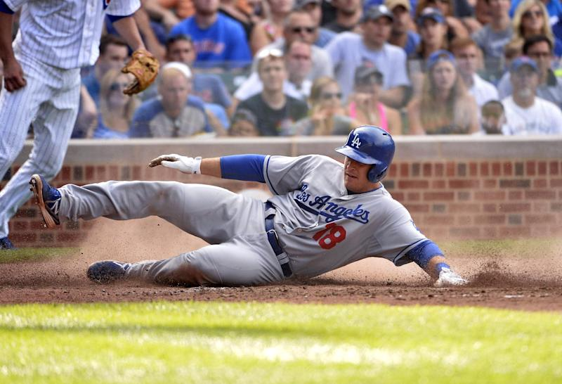 Los Angeles Dodgers' Tim Federowicz scores on an RBI single hit by Carl Crawford that also scored Skip Schumaker during the sixth inning of a baseball game against the Chicago Cubs, Saturday, Aug. 3, 2013, in Chicago. (AP Photo/Brian Kersey)