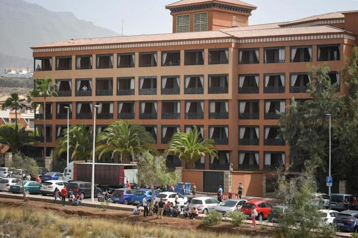 Police wearing masks and gloves could be seen surrounding the hotel in Costa Adeje on the southwestern shore of Tenerife (AFP Photo/DESIREE MARTIN)
