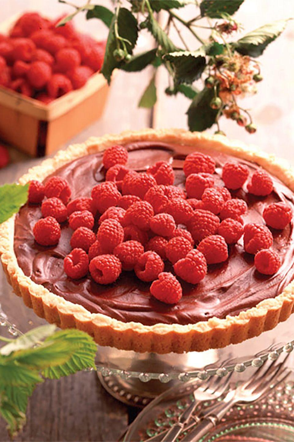 """<p>The rich chocolate filling topped with fresh raspberries is delicious enough on its own, but the buttery shortbread crust adds a savory crunch that makes this dessert irresistible. </p><p><strong><a href=""""https://www.countryliving.com/food-drinks/recipes/a7130/raspberry-ganache-tart-441/"""" rel=""""nofollow noopener"""" target=""""_blank"""" data-ylk=""""slk:Get the recipe"""" class=""""link rapid-noclick-resp"""">Get the recipe</a>.</strong></p>"""