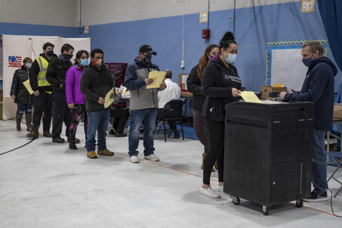 Voters lined up to cast their ballots at the Bishop Leo E. ONeil Youth Center Ward 9 polling place in Manchester, New Hampshire, one of the city's busiest, as Americans rushed to vote in the presidential election on November 3, 2020. (Jodi Hilton/NurPhoto via Getty Images)