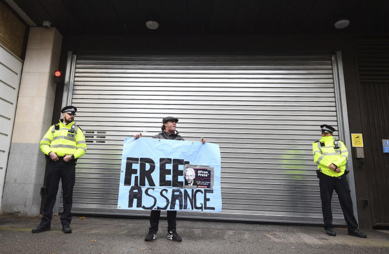 A supporters of Wikileaks founder Julian Assange demonstrate oustide Westminster Magistrates' Court in London where Assange is expected to appear as he fights extradition to the United States on charges of conspiring to hack into a Pentagon computer, in London, Monday, Oct, 21, 2019. U.S. authorities accuse Assange of scheming with former Army intelligence analyst Chelsea Manning to break a password for a classified government computer. (Victoria Jones/PA via AP)