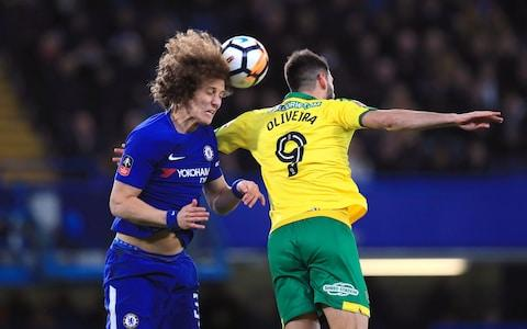 Chelsea's David Luiz (left) and Norwich City's Nelson Oliveira - Credit: PA