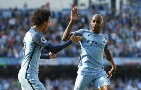 Britain Football Soccer - Manchester City v Hull City - Premier League - Etihad Stadium - 8/4/17 Manchester City's Fabian Delph celebrates scoring their third goal with Leroy Sane Action Images via Reuters / Ed Sykes Livepic