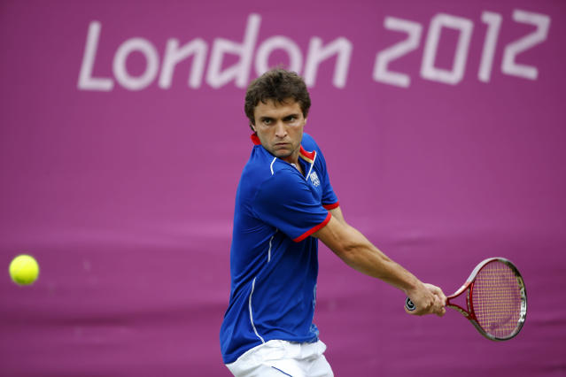 LONDON, ENGLAND - JULY 30: Gilles Simon of France plays a backhand during the Men's Singles Tennis match against Grigor Dimitrov of Bulgaria on Day 3 of the London 2012 Olympic Games at the All England Lawn Tennis and Croquet Club in Wimbledon on July 30, 2012 in London, England. (Photo by Jamie Squire/Getty Images)