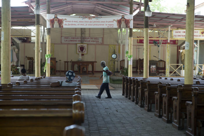 An elderly man walks inside the Sacre Coeur of Turgeau Catholic church in Port-au-Prince, Haiti, Wednesday, April 21, 2021. Catholic institutions including schools and universities closed Wednesday across Haiti as part of a three-day protest to demand the release of nine people including five priests and two nuns kidnapped more than a week ago amid a spike in violence the government is struggling to control. (AP Photo Joseph Odelyn)