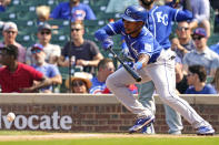 Kansas City Royals' Jarrod Dyson hits a one-run single on a bunt in the eighth inning of a baseball game against the Chicago Cubs, Friday, Aug. 20, 2021, in Chicago. (AP Photo/Nam Y. Huh)