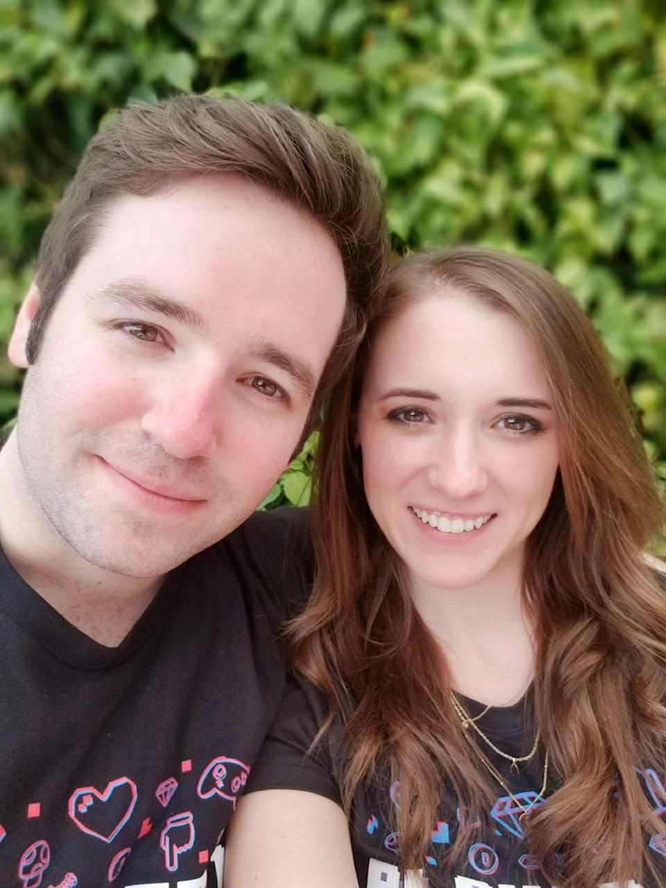 Josh Atkinson and Alexis Olson pose for a photo during a first date at Disney World in February 2019.