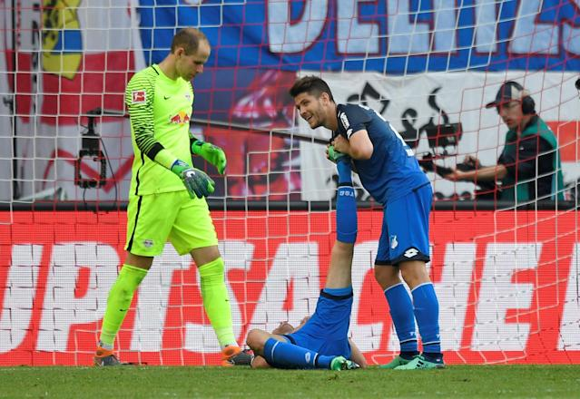 Soccer Football - Bundesliga - RB Leipzig vs TSG 1899 Hoffenheim - Red Bull Arena, Leipzig, Germany - April 21, 2018 Hoffenheim's Andrej Kramaric helps a cramp stricken team mate REUTERS/Matthias Rietschel DFL RULES TO LIMIT THE ONLINE USAGE DURING MATCH TIME TO 15 PICTURES PER GAME. IMAGE SEQUENCES TO SIMULATE VIDEO IS NOT ALLOWED AT ANY TIME. FOR FURTHER QUERIES PLEASE CONTACT DFL DIRECTLY AT + 49 69 650050
