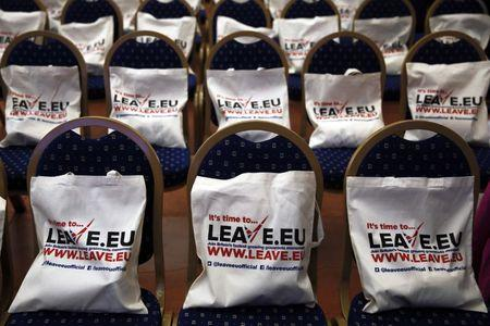 Campaign bags are placed on seats before the start of a Leave.EU campaign news conference in central London