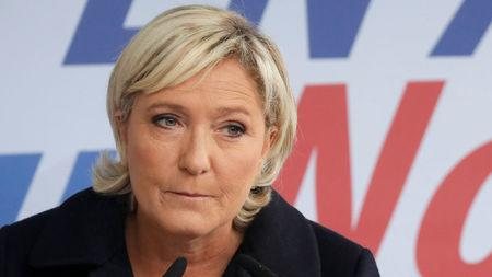 Member of parliament Marine Le Pen of France's far-right FN political party delivers a speech as she attends a political rally in Brachay