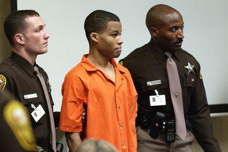FILE PHOTO --  Eighteen-year old sniper suspect Lee Malvo, (C), who was 17 at the time of the alleged crimes, appears in court during the trial of sniper suspect John Muhammad in Virginia Beach, Virginia, U.S.,  October 22, 2003. REUTERS/Davis Turner/Pool/Files