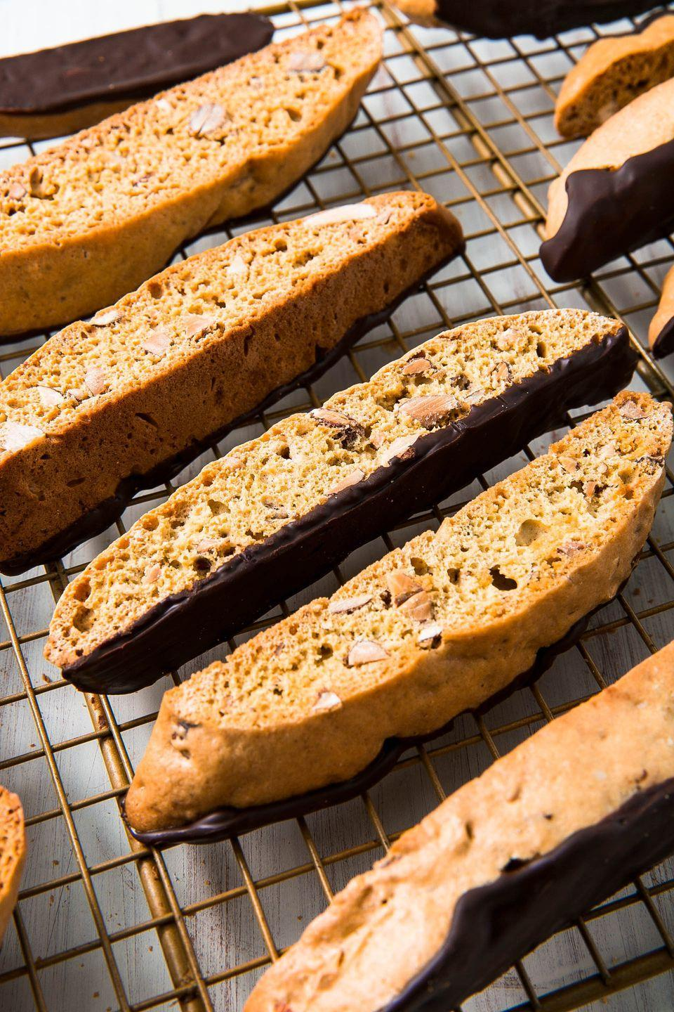 "<p>Biscotti is made to be a little dry (so that you can dip it in coffee!) which makes it perfect for sending as a gift. This biscotti is full of toasted almonds and can be dipped in chocolate for a little something extra. </p><p>Get the recipe from <a href=""https://www.delish.com/cooking/recipe-ideas/a25486278/biscotti-recipe/"" rel=""nofollow noopener"" target=""_blank"" data-ylk=""slk:Delish"" class=""link rapid-noclick-resp"">Delish</a>.</p>"