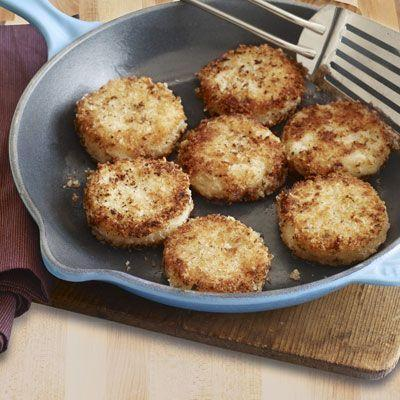 """<p>An easy used for mashed potatoes, these cakes need just a little panko, chopped onion, and herbs.</p><p><strong><a href=""""https://www.countryliving.com/food-drinks/recipes/a3495/crispy-rosemary-potato-cakes-recipe-clv1110/"""" rel=""""nofollow noopener"""" target=""""_blank"""" data-ylk=""""slk:Get the recipe"""" class=""""link rapid-noclick-resp"""">Get the recipe</a>.</strong></p><p><strong><a class=""""link rapid-noclick-resp"""" href=""""https://www.amazon.com/Tramontina-80114-535DS-Professional-Restaurant/dp/B009HBKQ16/r?tag=syn-yahoo-20&ascsubtag=%5Bartid%7C10050.g.1064%5Bsrc%7Cyahoo-us"""" rel=""""nofollow noopener"""" target=""""_blank"""" data-ylk=""""slk:SHOP SKILLETS"""">SHOP SKILLETS</a><br></strong></p>"""