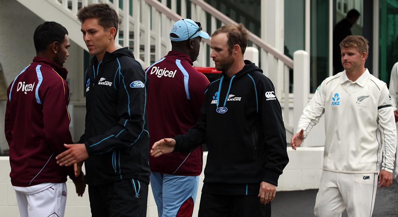 DUNEDIN, NEW ZEALAND - DECEMBER 07: Trent Boult, Aaron Redmond and Corey Anderson of New Zealand acknowledge West Indies players after a rain-forced draw after day five of the first test match between New Zealand and the West Indies at University Oval on December 7, 2013 in Dunedin, New Zealand.  (Photo by Rob Jefferies/Getty Images)